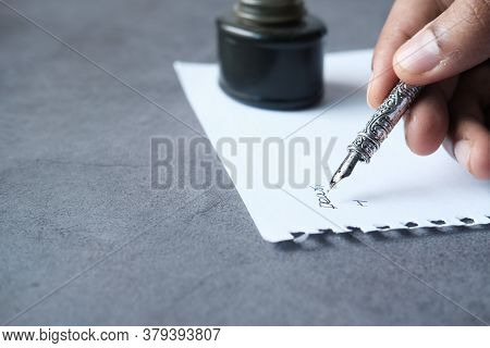 Close Up Of Man Hand Writing A Letter With Fountain Pen