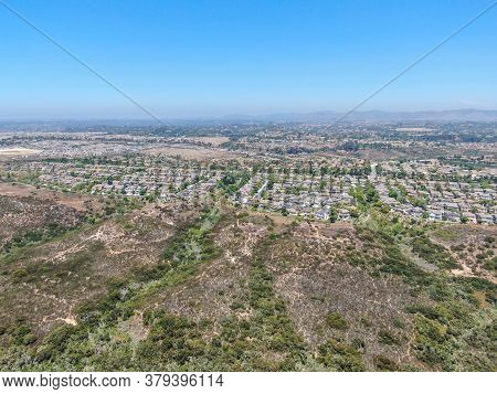 Aerial View Of Los Penasquitos Canyon Preserve With Torrey Santa Fe Middle Neighborhood With Residen