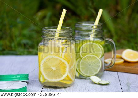 A Refreshing Cocktail Of Lemon And Lime Poured Into Trendy Jars With Handles Lids And Tubes