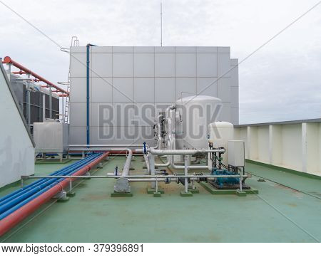Chiller Tower Or Cooling Tower On Rooftop Of A Office Building. System Work. Architecture Machine. C