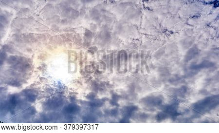 Gentle Sunset Against The Background Of Feathery Clouds. Color