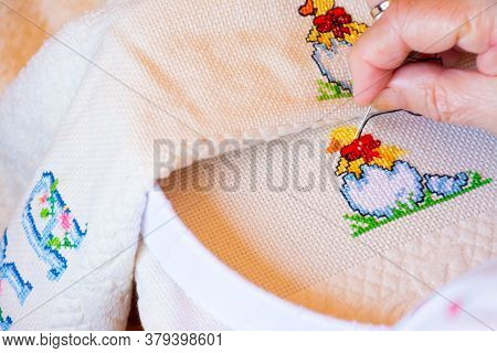 Woman Creating Black Details To A Colorful Cross Stitch Design With Animals And Letters. Concepts Of