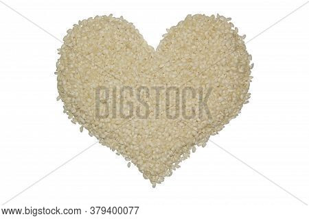 Rice Heart. Round White Rice Arborio Isolated On A White Background. Heart Made From Groats. Ingredi