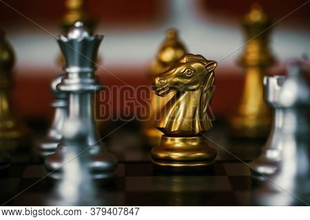 The Golden Knight On The Board Game Of Chess.the Knight Is A Piece In The Game Of Chess And Is Repre