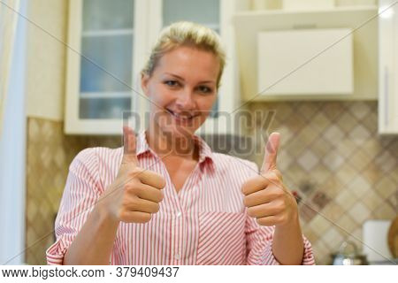 Beautiful Woman Housewife Smiling Shows Approval. Buying A New Kitchen For The Interior.