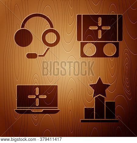 Set Star, Headphones, Laptop And Portable Video Game Console On Wooden Background. Vector