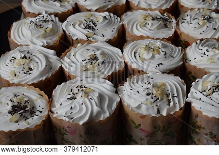 Easter Cakes With Candied Fruit, White Glaze And Sprinkles, Fresh, Side View, On A White Background