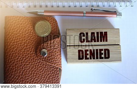 Wood Blocks With Text: Claim Denied, Wallet, Pen, Coins. Insurance Concept.