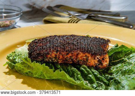 Cajun Cuisine Blackened Salmon Steak On Marble Kitchen Table