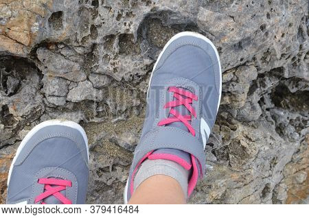 Mood Photo Of Legs Wearing Sportive Hiking Shoes With Strong Protective Sole. Legs In Trekking Footw