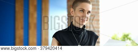 Portrait Of Happy Feminine Looking Away With Gladness And Calmness. Smiling Female Person Playing Sy