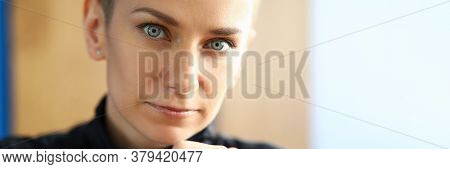 Close-up Of Lovely Woman Looking At Camera With Calmness And Seriousness. Serious Female Person Touc