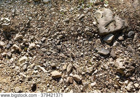 The Texture Of Stone Soil. Background Image Of A Stone Crumb With Small And Large Stones. Closeup