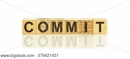 Commit Word Written On Wood Block, Concept Commitment
