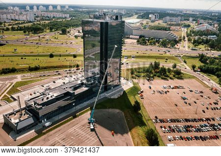 View From The Height Of The Car Of A Heavy Crane With A Cradle, Which Is Opened In The Parking Lot N