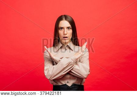 What Is It. The Female Portrait Isolated On Red Studio Backgroud. The Young Emotional Angry, Scared