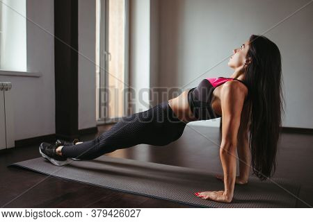Home Training, Fitness, Motivation Concept. Young Fit Woman Doing Sport Exercises In Her Living Room