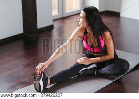Home Training, Sport, Fitness. Self Development And Well Being. Young Fit Woman Doing Stretching Exe