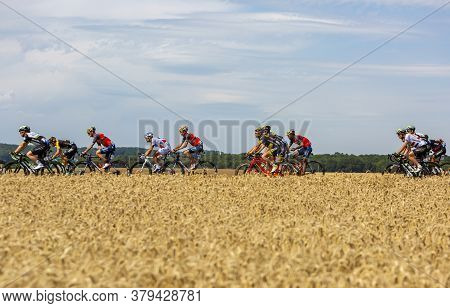 Vendeuvre-sur-barse, France - 6 July, 2017: The Peloton Passes Through A Region Of Wheat Fields Duri
