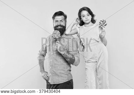 Eat Dessert First. Happy Family Hold Candy Dessert On Stick. Father And Daughter Yellow Background.
