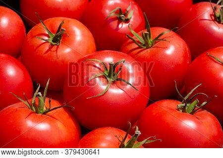 Close-up Of Mellow Red Tomatoes On Market Counter