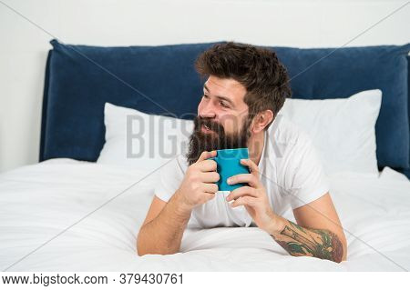 Man Happy Bearded Face Drink Morning Coffee Relax In Bedroom, Caffeine Dose Concept.