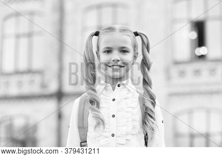 What Do You Know. First Day Of School. Happy Schoolgirl Urban Background. Little Schoolgirl Back To