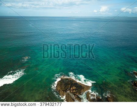 Aerial View Of Sea With Crystalline Green Waters.