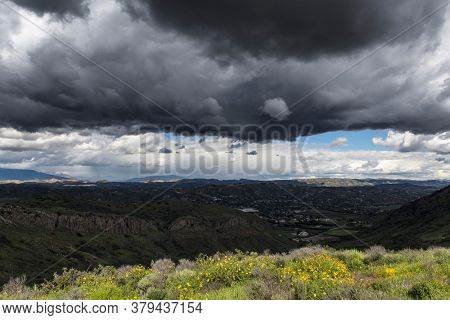 Hilltop view of  thunderstorm above Santa Rosa Valley near Camarillo and Thousand Oaks in Southern California.