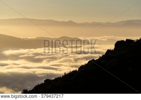Early morning view of misty mountains ridges and canyons north of Chatsworth in Los Angeles, California.