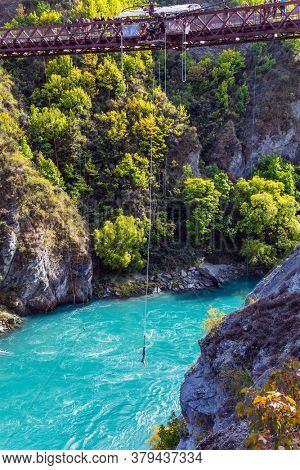 Extreme Sports - bungee jumping into the abyss upside down. Incredible Adventures in New Zealand. River and bridge Kawarau. The concept of extreme, active and photo tourism