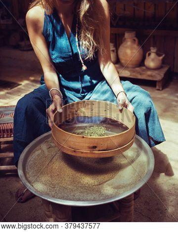 Woman Making Homemade Spices, Dry Zaatar. Traditional Lebanese Seasoning. Natural Antioxidant.