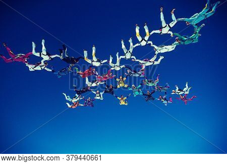 Low angle view of Skydivers in Formation