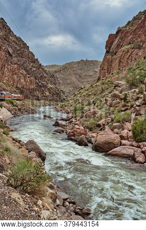 Ravine With Train And River In Colorado