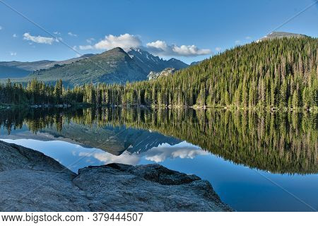 Bear Lake In Rocky Mountain National Park Colorado Early Morning Reflection. Reflective Photo Of Gla