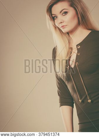 Fashionable Outfit Ideas, Trendy Clothes Concept. Attractive Blonde Woman Wearing Tight Dark Green K