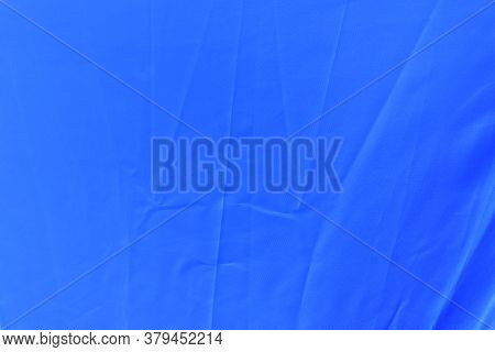Blue Waterresistant Fabric Close Up Of Umbrella Canopy Surface With Folding Wrinkles