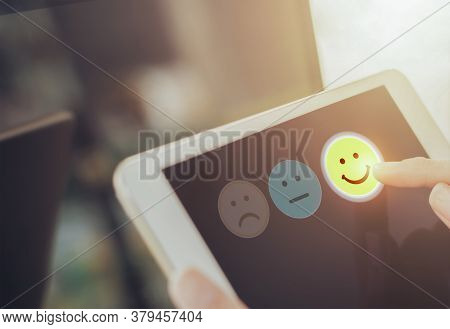 Businesswoman Pressing Face Emoticon On Virtual Touch Screen At Digital Tablet .customer Service Eva