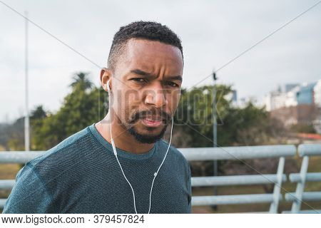 Athletic Man Listening To Music.