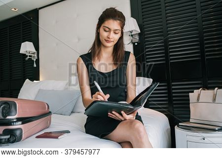 Businesswoman Working At Hotel Room.