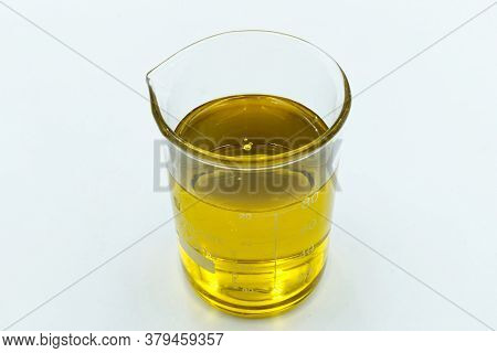 Italian Extra Vergin Oil In A Measuring Cup Isolated On White Background