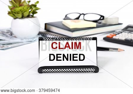 Claim Denied. Text On A White Background. Plants And Money. View From Above.