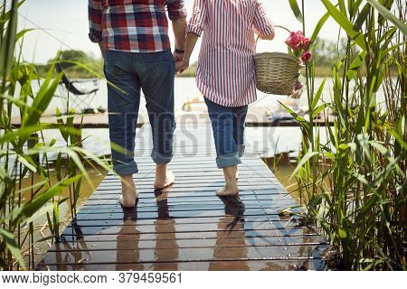 Lovely old couple going to picnic on a beautiful weather