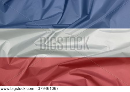 Fabric Flag Of Yugoslavia (1918-1941). A Horizontal Triband Of White Blue And Red.