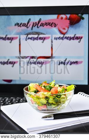 A Meal Plan For A Week. Bowl With Vegetable Salad In The Workplace Near The Computer. Lunch In The O