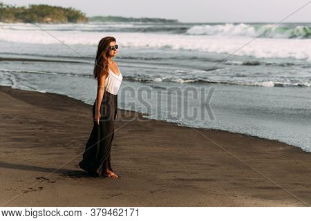 Beautiful Woman Model By The Sea. Portrait Of Happy Young Woman Smiling At Sea. Beautiful Young Brun