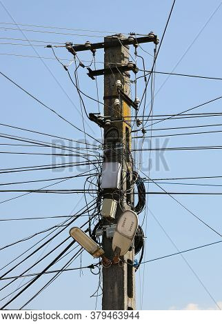 Chaos Of  The Cables And Wires On An Electric Pole, Romania