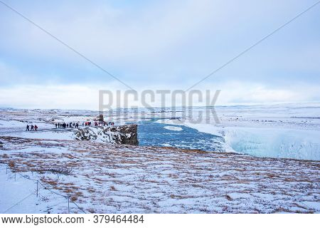 Gullfoss, Iceland - March 4, 2020: People At Viewpoint Over Gullfoss Waterfall, One Of The Most Popu