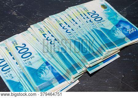 Banknotes Of 200 New Israeli Shekels Lie On A Black Background.