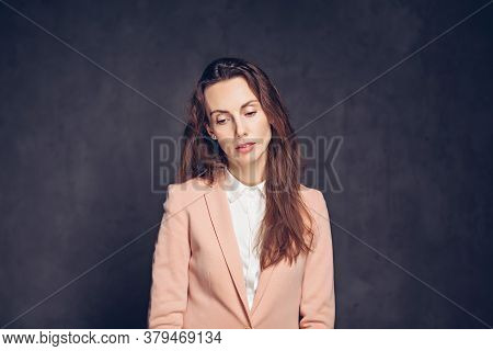 Depressed Adult Caucasian Woman On Grey Dark Background With Copy Space
